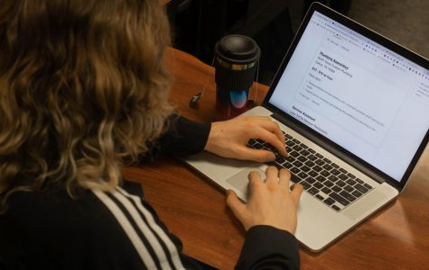 Junior Brian Bock browses Indeed's listings. Indeed is a site used to search and apply for jobs. Their network allows applicants to create and/or upload resumés for employer's to view. In the attached column, writer DaNita Griffin offers tips for job-seekers.