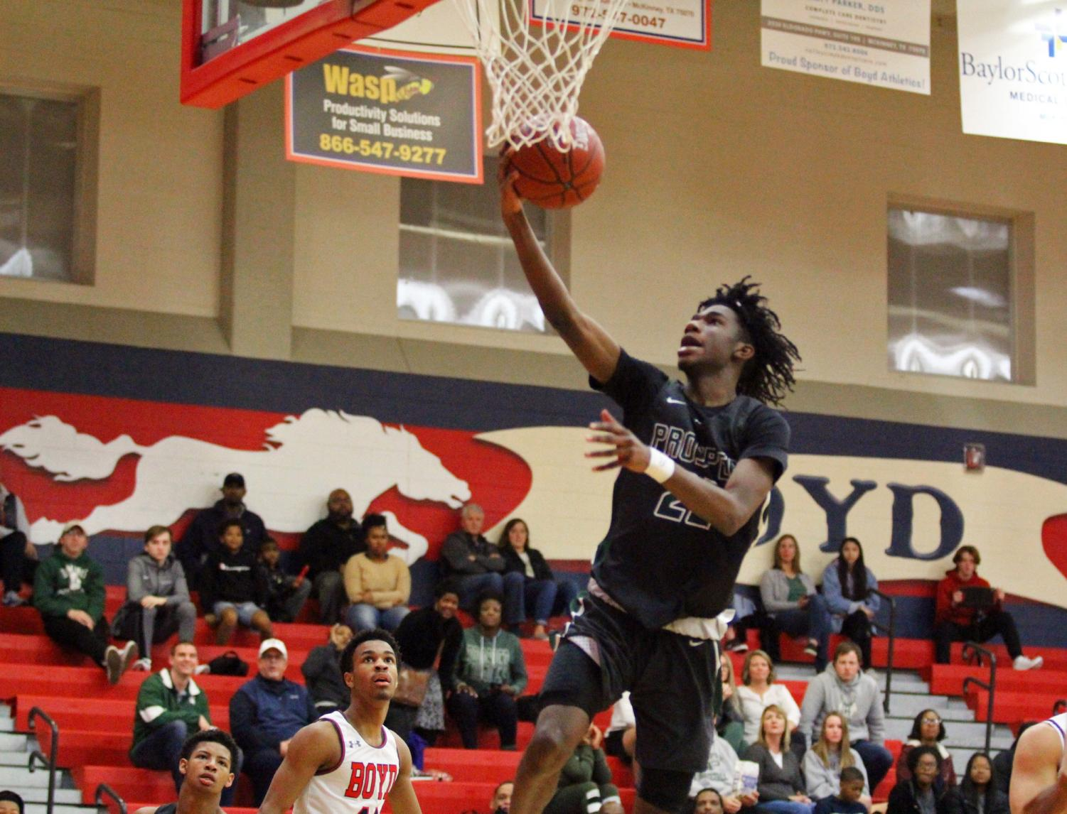 Senior Mondo Battle jumps to make a basket. Battle put up 25 points on Tuesday night. The Eagles play against the Plano West Wolves on Jan. 10.