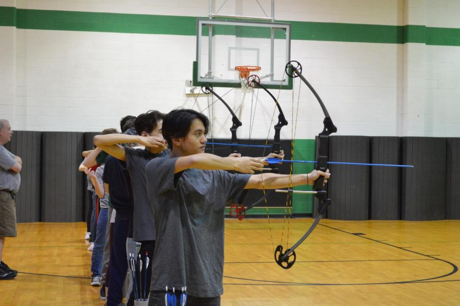 During+the+beginning+of+the+third+round+at+10+meters%2C+junior+Ethan+Doucet+aims+and+draws+his+arrow+in+an+effort+to+score+a+bullseye.+Archery+team+member+and+photojournalist+Julia+John+captured+this+moment+Tuesday%2C+Feb.+25.+%22Archery+is+mostly+a+mental+thing%2C%22+junior+Emily+Reish+said.+%22We+have+to+think+of+many+things+before+releasing+the+arrow.%22