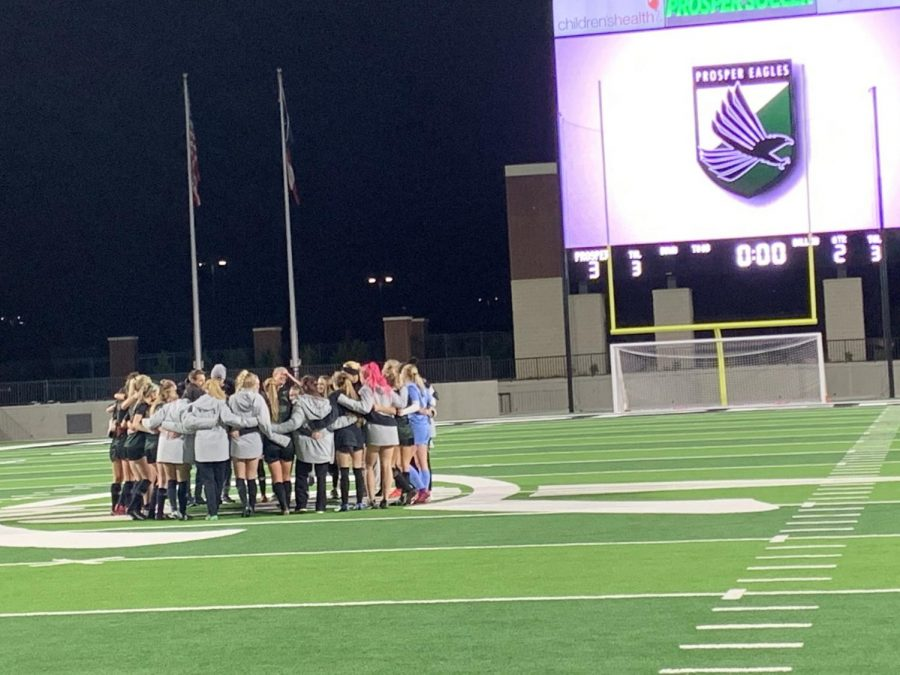 The+girls+soccer+team+celebrate+their+win+on+Feb.+7.+The+team+went+against+the+Allen+Eagles+and+won+3-2.+Allen+was+ranked+%232+in+the+state.
