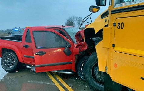 Truck hydroplanes into school bus on Coleman Street