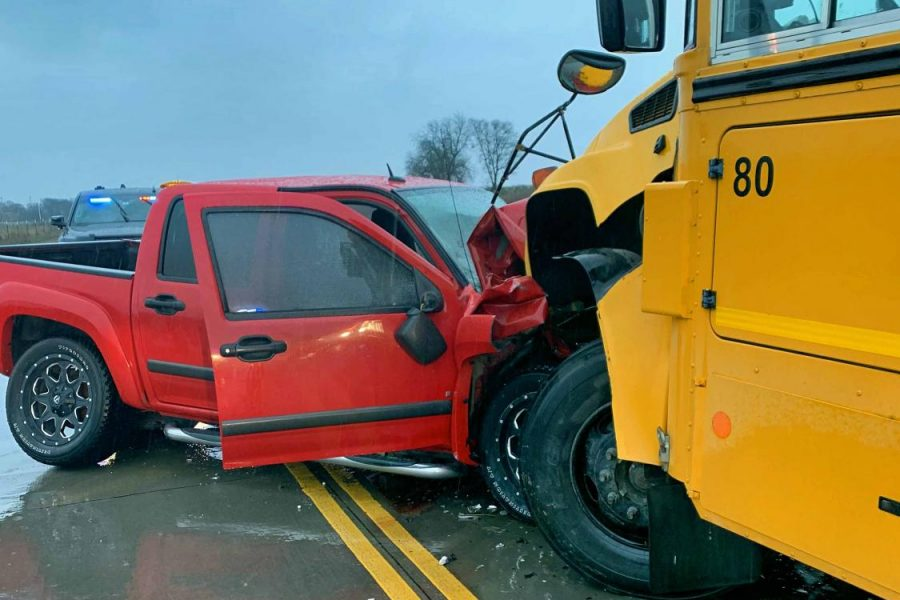 Wreckage fills Coleman street around 8 a.m. this morning after a student driver of a red Chevrolet Colorado pickup truck hydroplaned into Bus No. 80. The bus had no passengers. Two students from the truck were transported by ambulance to the local Baylor Scott and White hospital for examination.  Prosper ISD police officials reported no serious injuries resulted from the accident.