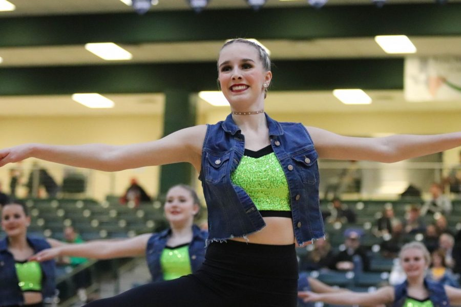 Senior+Captain+Alexa+Wheeler+performs+a+pirouette+during+the+team+dance+at+Friday%27s+varsity+boys+basketball+game.+A+pirouette+is+a+style+of+turn+that+is+popular+in+the+dance+world.+The+Talonettes+used+pirouettes+in+many+of+their+routines+this+season.