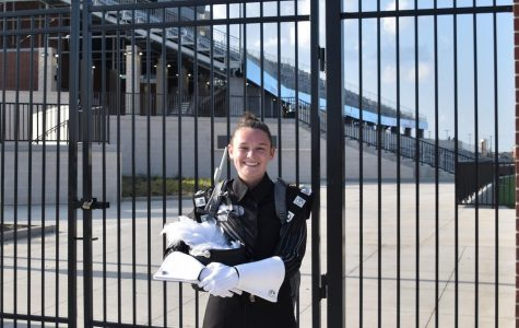 Senior Maddi Weaver stands in her marching uniform outside of Children's Health Stadium.