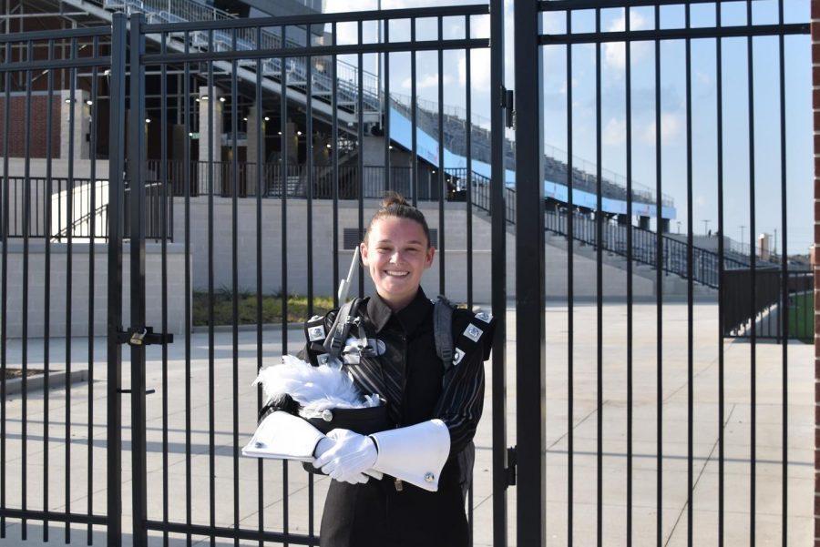 Senior Maddi Weaver stands in her marching uniform outside of Children's Health Stadium.