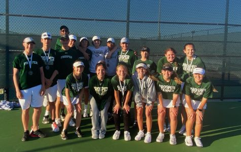 The tennis team poses for a photo at the end of the Prosper Invitational. Four teams placed in the top four. The team will compete in the McKinney North pool play on Thursday, Mar. 5.