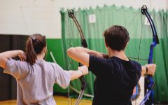 Sophomore Jessica Hampton and Freshman Sean Rich, set up their shots and aim for their targets. Both archery teams practice two nights a week in preparation for upcoming tournaments.