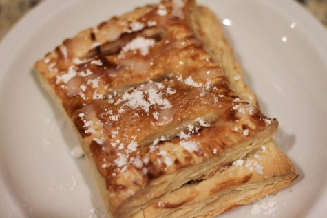 """A fresh strawberry turnover sits on a plate, dusted in powdered sugar. The Reese family took the time to make strawberry turnovers this past week as a family bonding activity. """"They didn"""