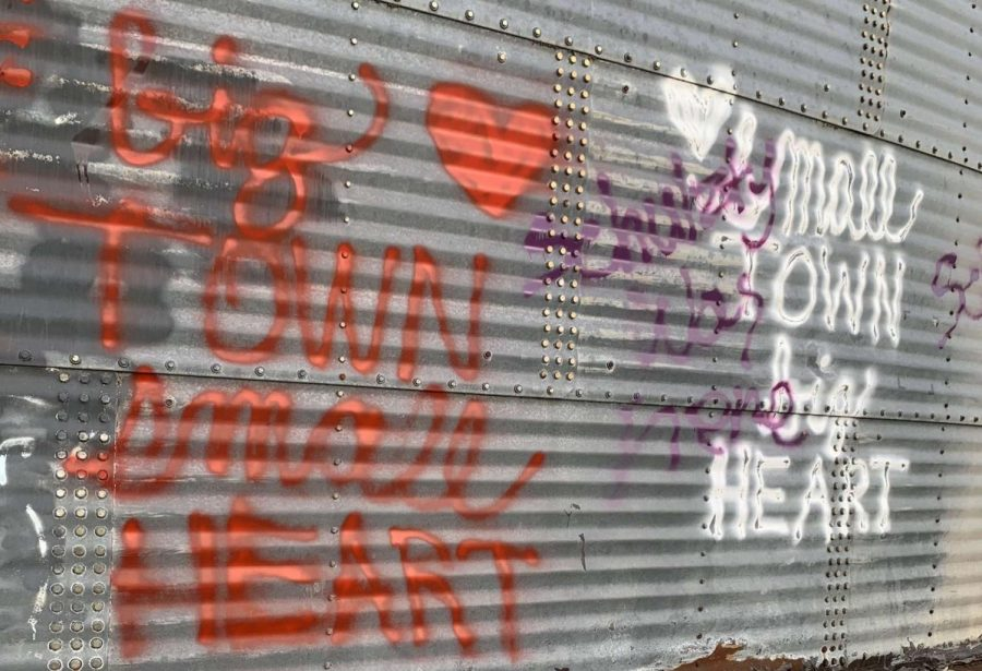 The+words%2C+%22Big+town%2C+small+heart%2C%22+sit+next+to+the+original+saying+on+the+silos+in+downtown+Prosper.+The+people+responsible+for+this+graphitti+have+yet+to+be+identified.+%22While+this+may+seem+like+just+a+teenager+messing+around+with+a+can+of+spray+paint%2C%22+opinion+writer+Emma+Hutchinson+said.+%22It+could+be+a+message+that+has+been+yearning+to+reach+the+surface.%22+