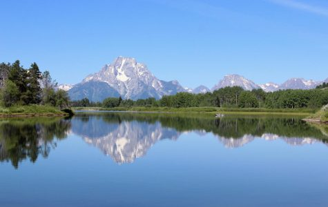The reflection of the Grand Tetons glistens on the bend of a river in Teton National Park. Not only has this section of the park become famed for its photography potential, but also for its kayaking and fishing.
