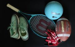A tennis racket, volleyball, football, running shoes and gloves wait to be used by high athletes. The University Scholastic League took action today, July 21, to delay fall sports for 5A and 6A conferences, including volleyball, football, tennis and cross country. The first competions for each sport will not occur for at least five weeks.