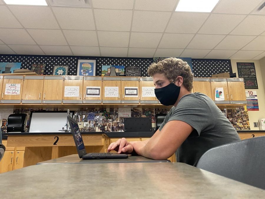 """Due to COVID-19, sophomore Evan Bish and all students inside classrooms look different this year thanks to required face coverings.  Technology employees issued each student a Chromebook for the school year to help reduce the number of shared items. """"The mask doesn't bother me because I know it will pay off in the end,"""" Bish said. """"Keeping everyone safe is important for many reasons, but I just want a football season."""""""