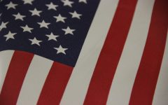 An American flag hangs in the Eagle Nation Online newsroom. Today, Sept. 11, many students will be looking to classroom flags as they commemorate the 19th anniversary of the events of Sept. 11, 2001. Motivational speaker Sujo John tells his story of 9/11 and how much he loves America in the attached article.