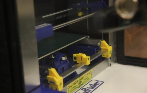 A 3D printer sits inside the new
