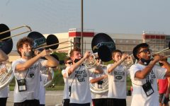 With their horns up, the Prosper Mighty Eagle Band practices their 2020 halftime show. The band is set to perform their show with scores from Earth Wind and Fire at home football games.
