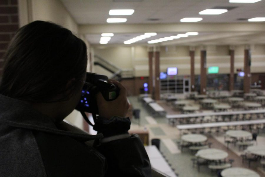To practice her photography skills, junior Paige Hursman takes a photo of the empty cafeteria. Hursman said that she's loved taking pictures since she was little.