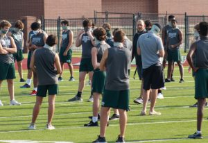 """Socially distanced, Prosper Eagles football head coach Brandon Schmidt lectures players on junior varsity and varsity. Both teams were doing walk-throughs for their games on Thursday and Friday. """"COVID has had a big impact on how we practice,"""" Schmidt said. """"It has impacted almost every aspect of our program including position meetings, weight room workouts, and study hall."""""""