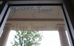 "Hope Squad students write reminders on the windows in the halls. Hope Squad wrote these messages during Suicide Prevention Week, but also writes them frequently as a reminder for students. ""During class we walk around and write positive things"" Hope Squad member Junior Alyssa Clark said.  ""We hope these uplift people's days."""