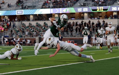 Diving over his opponent, senior Keaton Nickerson makes his way down the field. Prosper won their first game on Sept. 25 against Prestonwood by 10 points, 27-17.