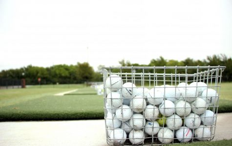 One in a series of golf baskets sits lined up along the high school golf range. The golf team competed at the Frisco Lakes Golf Club Sept. 21.