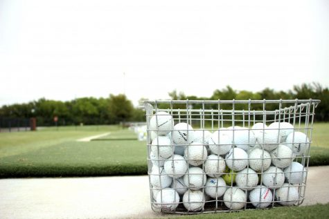 "One in a series of golf baskets sits lined up along the high school golf range. The golf team competed at the Frisco Lakes Golf Club Sept. 21. ""I don"
