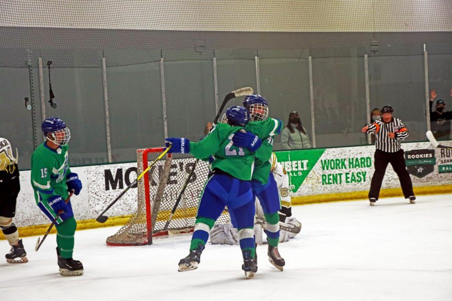 Following a score, Brendon Zeis hugs teammate Mason Novak, No. 41, to celebrate their second goal of the game. Prosper was up 2-1 in the second period. Zeis had 2 points for the game, while Novak had 1 goal.