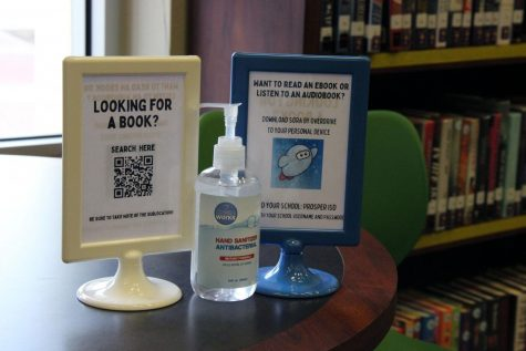 """Directions to the virtual book collection sit on a table in the newly renovated Future Ready Space. The Future Ready Space used to be the library, and now contains a new layout and a """"makerspace,"""" containing tools for students to utilize. """"The idea is that it looks less like a quiet place to read a book and study, and more of a collaborative place where anybody can learn or do anything,"""" Future Ready Designer Ryan Miller said. """"We still have a really large library collection. We're still here to help with literacy and research and things like that. We also want the space to be usable by everybody."""""""