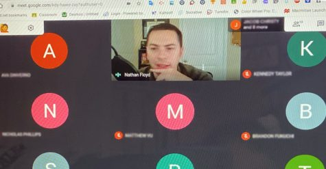 "With physics as his topic, teacher Nathan Floyd leads class from home on a Google Meet.  Floyd is in-person on A-days and goes virtual on B-days. ""I think there"