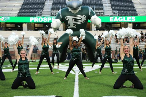 """Ending with a hands-in-the-air flare, the Talonnettes close their first performance of the year. Led by Captain Zoe Dale, the drill team works daily to perfect their routines, which are performed at several different events through the course of the year. """"It"""