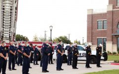 The staff of the Prosper Fire Department stand heads bowed in remembrance of the lives lost in the terrorist attacks of Sept. 11, 2001. This fire station is located on East First Street. Community members in attendance were asked to comply with social distancing guidelines.