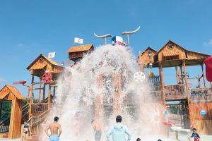 Hotel guests endure in a splash at the Paradise Springs kids area. The Gaylord Texan includes premium access to the Paradise Springs Waterpark, a new addition to the area. This kid-friendly water park also features multiple waterslides for family fun.