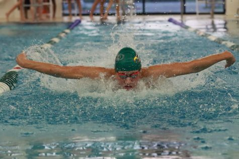 Coming up from his dive into his lane, Hayden Jestes breaks out with the first 50-yard butterfly leg.  Jestes, a senior, competes on the varsity team. He competed in the 200 individual medley event.