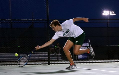 Reaching to secure a point during his match, sophomore Cameron Youtsey takes his racquet to the ground and lunges for the ball. The tennis team played its first series of matches against Plano East Tuesday, Sept. 8, on the home courts.