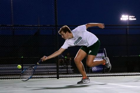 "Reaching to secure a point during his match, sophomore Cameron Youtsey takes his racquet to the ground and lunges for the ball. The tennis team played its first series of matches against Plano East Tuesday, Sept. 8, on the home courts. ""I had so much fun,"" Youtzey said, ""and felt like I was on fire."""