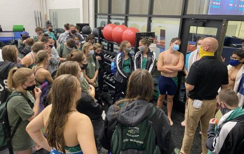 After the meet, the swim team gathers in the weight room. Awards are being given out to the Prosper swimmers by head coach Trey Sullivan. The awards are to congratulate the two