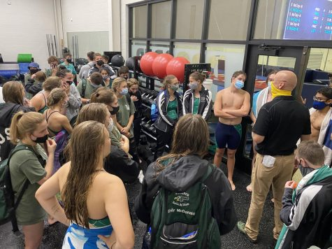 "After the meet, the swim team gathers in the weight room. Awards are being given out to the Prosper swimmers by head coach Trey Sullivan. The awards are to congratulate the two ""top"" swimmers on their efforts during the meet."