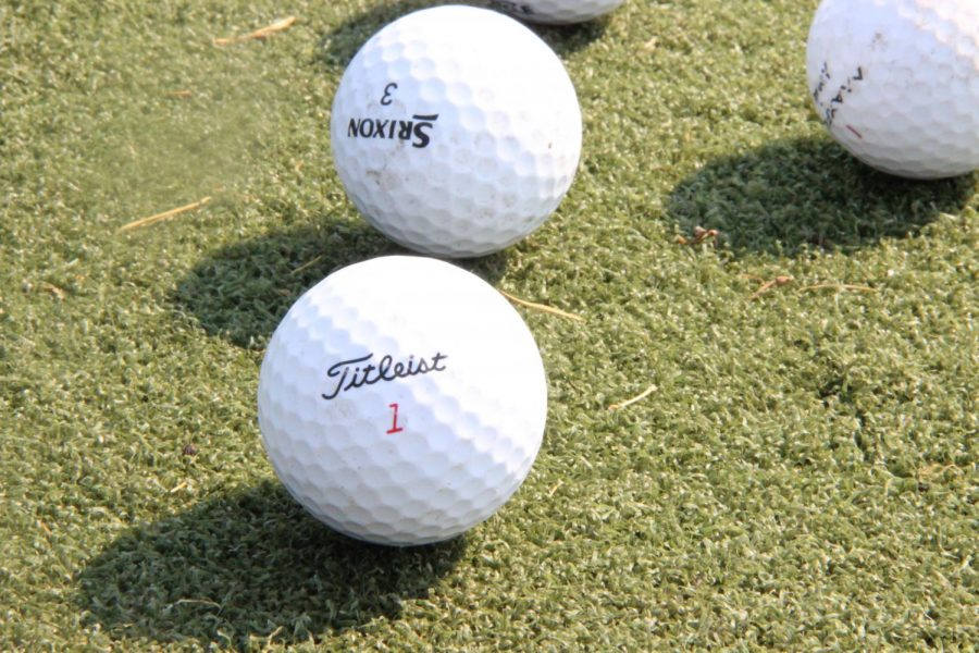 """A golf ball rests on a practice mat by the tennis courts. The team recently had a tournament where the boys competed on Monday, Oct. 5, and the girls competed on Oct. 2-3. """"We learned a lot about our team today,"""" boys head coach Nick Sharp said. """"We hit the ball well, but just couldn"""