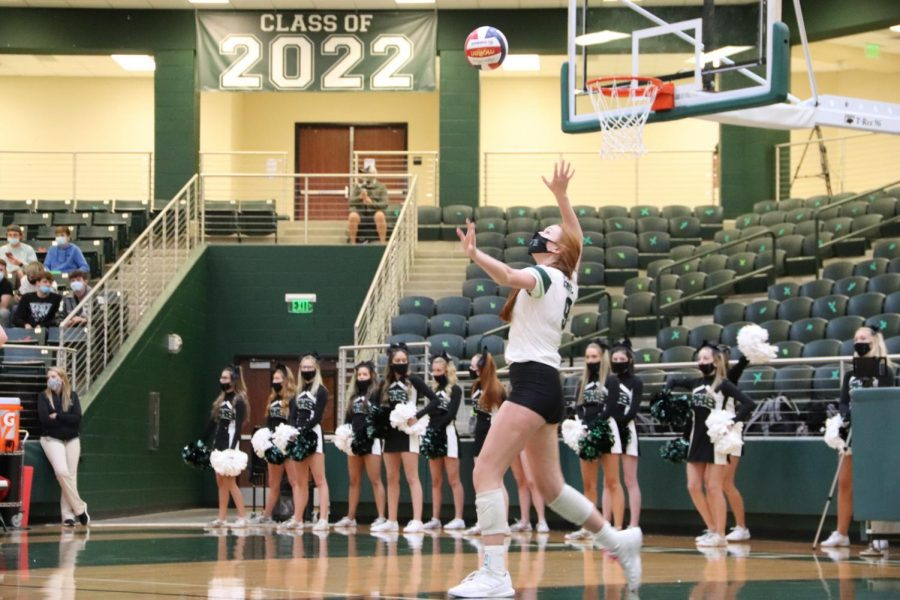In a game from last years season, now-junior Ella Chaney prepares to serve the ball over in a winning game versus Braswell. Chaney and the Prosper Eagles have a current season score at 19-7. District play will start this Friday, Sept. 10, at home against Little Elm.