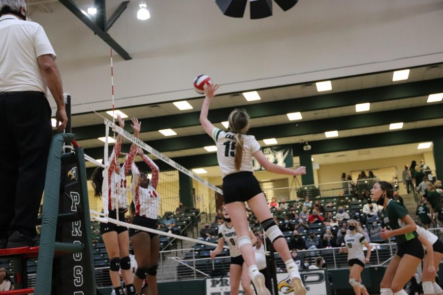 As she moves up to hit the ball over, senior Nikki Steinheiser approaches the net. Prosper won the first set of the game 25-15. Their next game is Tuesday, Oct. 27 against Guyer High School.