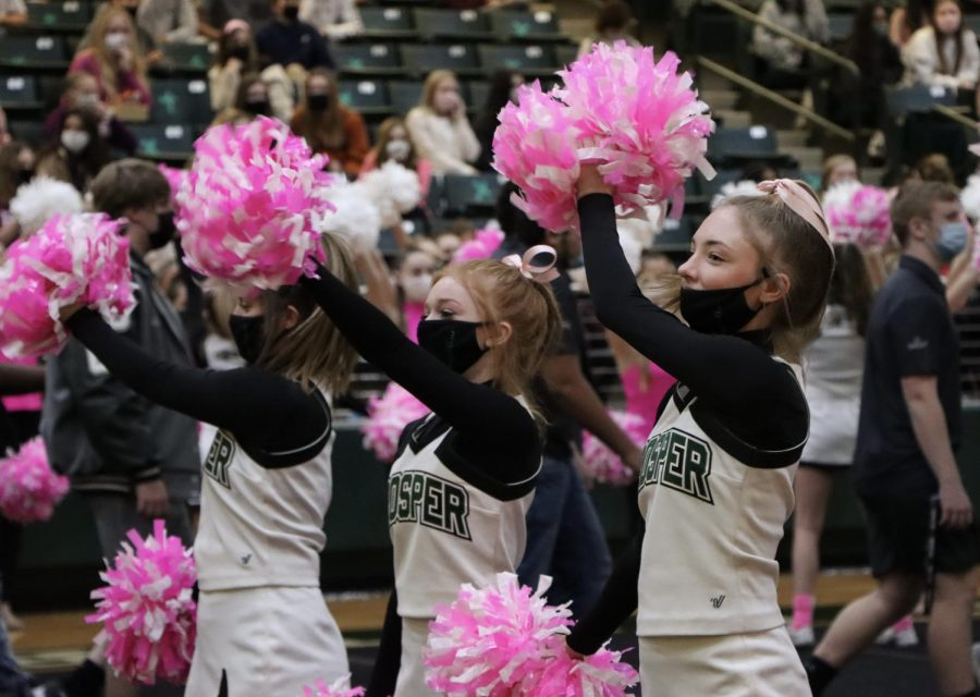Waving their pom-poms, junior varsity cheerleaders dance to the band's music. Although the pep rally was for sophomores and seniors in person, all of the cheer team was able to attend.