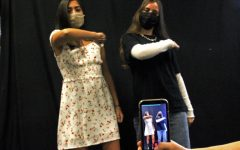 As they perform for a recording, sophomore Gianna Galante and senior Emily Reish do a TikTok dance to