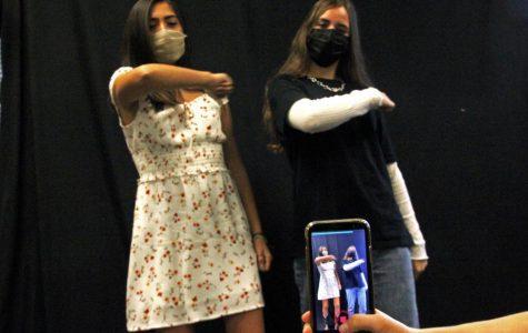 As they perform for a recording, sophomore Gianna Galante and senior Emily Reish do a TikTok dance to