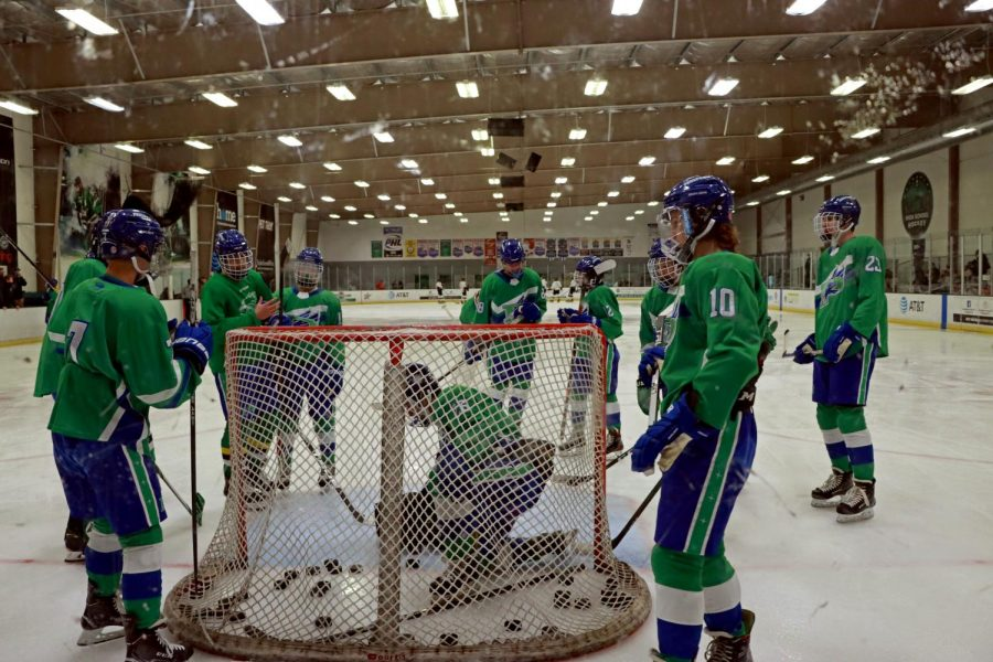 The+Prosper+community+hockey+team+gathers+by+the+goal+during+their+game+against+Plano+East+High+School+on+Sept.+24.+Prosper+defeated+Plano+East+5-1.+%22Yes+we+might+be+a+hockey+team%2C%E2%80%9D+head+coach+Yev+Saidachev+said.+%E2%80%9CBut+we+want+people+to+know+our+program+of+fine%2C+young+individuals+who+have+good+heads+on+their+shoulders.+The+only+way+we+do+that+is+if+we+treat+people+the+right+way.%E2%80%9D%0A