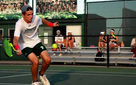 As he rushes the net, senior Jett Anderson prepares to hit a volley. Anderson won his match 6-1, 6-3. Anderson also plays doubles with junior Drew John.