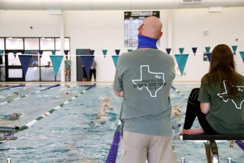Head swim coach Trey Sullivan stands with sophomore Bailee Nelson before their meet on Wednesday, Sept. 30. The team defeated Plano Senior High School. Swim will face off against Lovejoy at 7 p.m. on Wednesday, Oct. 7 at the PISD Natatorium.