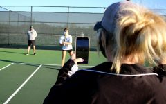 Assistant tennis coach Hollie Cunningham films head tennis coach Mandy Weaver and athletic trainer Michael Henry in a TikTok. Weaver and Henry have set a tradition to make a new TikTok every Friday. In the attached feature, sports editor Caroline Wilburn highlights coach Marco Regalado from Eaton High School, who takes the same approach as Weaver and Henry.