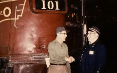 Sophomore Connor Striegel's great-grandfather (left), a former railroad employee, shakes hands with a friend in this photo, which sits in  Striegel's house. Striegel said he has a love for trains that first originated with his family's relationships to them.