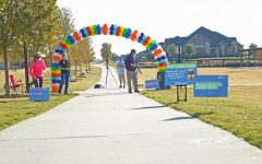 An arch of rainbow balloons marks the beginning of the walking route.
