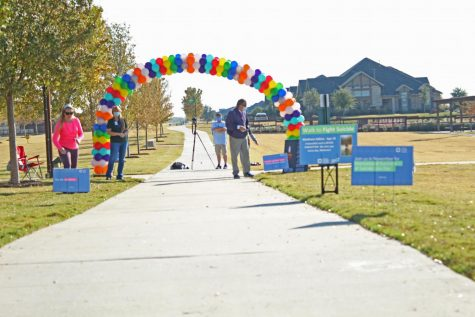 "An arch of rainbow balloons marks the beginning of the walking route. ""Out of the Darkness Walk"" drew hundreds of participants to the Windsong Ranch neighborhood in Prosper Saturday, Nov. 7. ""I thought it was so cool to see how many people came out to support and raise awareness to suicide prevention,"" sophomore Hope Squad member Landon Bownds said. ""It was nice to see both schools and the shared community come together for a really important cause"""