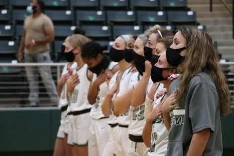 With their hands over their chests, the Lady Eagles stand while the national anthem is played. The team played the first game of the season on Saturday, Nov. 7, against Wylie. Previously, they played a scrimmage against Frisco Liberty Nov. 2.